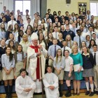 Cardinal Dolan and Mrs. Merryman pose with the senior class.