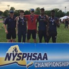 From left to right: Coach Slinskey, Aiden Reilly, Nick Timm, Safo Kirton, and Jaheim Jones after ...