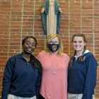 Mrs. Merryman poses with Valedictorian '21 Moira Kennedy (right) and Salutatorian '21 Sedem Apedo...