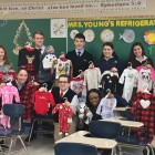 Student pose in Mrs. Young's class with their contributions to the annual collection for Abraham ...