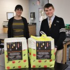 "Andrew and Mrs. Cuccia, NHS Moderator pose with ""Treats for Troops""."