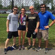 Caroline Timm celebrates with Coaches Mike Slinskey, Phil Tullo and Keaton Mangi.