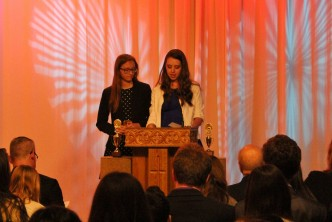 Morgan Hurst and Kayleigh Goebelbecker (on behalf of Maggie Roach) accept the Eddy Award in the Photo Essay category.