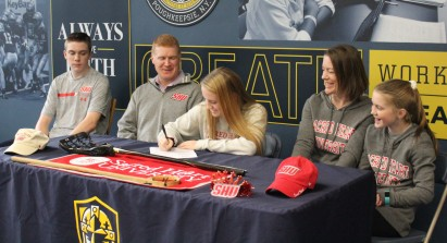 Maeve Connolly signs her National Letter of Intent to play for Sacred Heart University while her ...