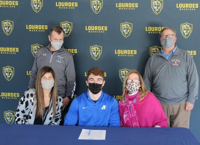 Joe Krauza celebrates his signing with Lourdes Principal, Catherine Merryman, Assistant Principal...