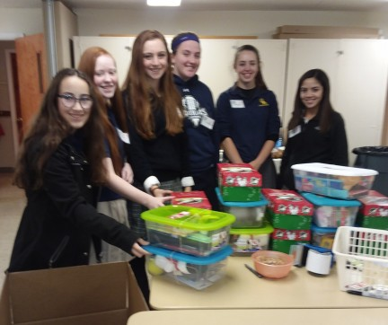 "<font face=""sans-serif"">NHS students helped to pack <em>Operation Christmas Child</em> shoeboxes at Vassar Road Baptist Church. <br/>Left to right:  </font><font face=""sans-serif"">Sara Bucher, Mary Connor, Annaeliese Clark, Madeline Butts, </font>Morgan Hurst, and Leslie Mendoza."