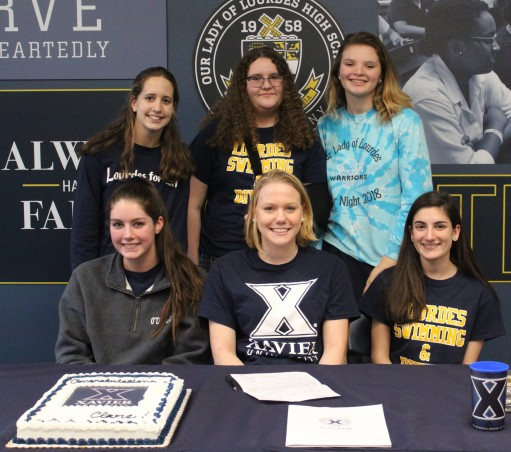 Several Lourdes Varsity swimmers were on hand for Clare's signing.