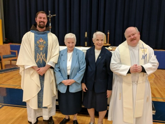 Sr. Ann Belz and Sr. Anne Manion pose with Father Lutz and Father Eric Lenhart, OFM, Capuchin from CFY after renewing their vows. Sr. Ann Belz will celebrate her diamond jubilee this year and Sr. Ann Manion celebrated her golden jubilee 2 years ago.