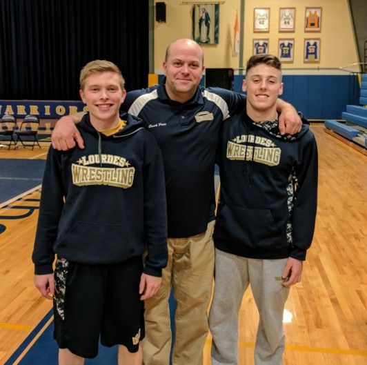 Seniors Bobby Seymour and Lucca Ardovini pose with Coach Price before meet.