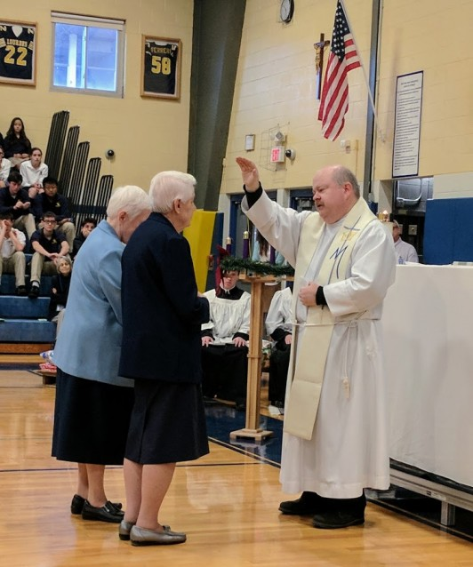 "Father Tom Lutz blesses Sr. Ann Belz and Sr. Anne Manion as they renewed their vows at our Mass for the Feast of the Immaculate Conception. Both have dedicated their lives to <a href=""http://ihmimmaculata.org/"">Sisters, Servants of the Immaculate Heart of Mary</a>."