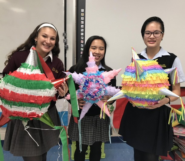 Samantha Bowen, Klyanna Ediong, and Cecilia Mak show off their creations.