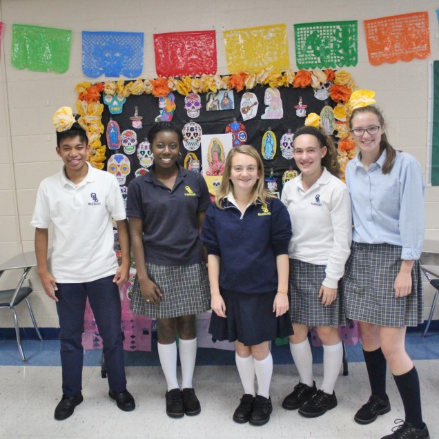 Spanish Club members pose in front of the altar they created.  Sophomore, Justin Cerdena, Club Vi...