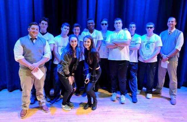 Alexis and Mackenzie pose with the Mr. Warrior contestants and emcees: From left to right:  Mr. W...
