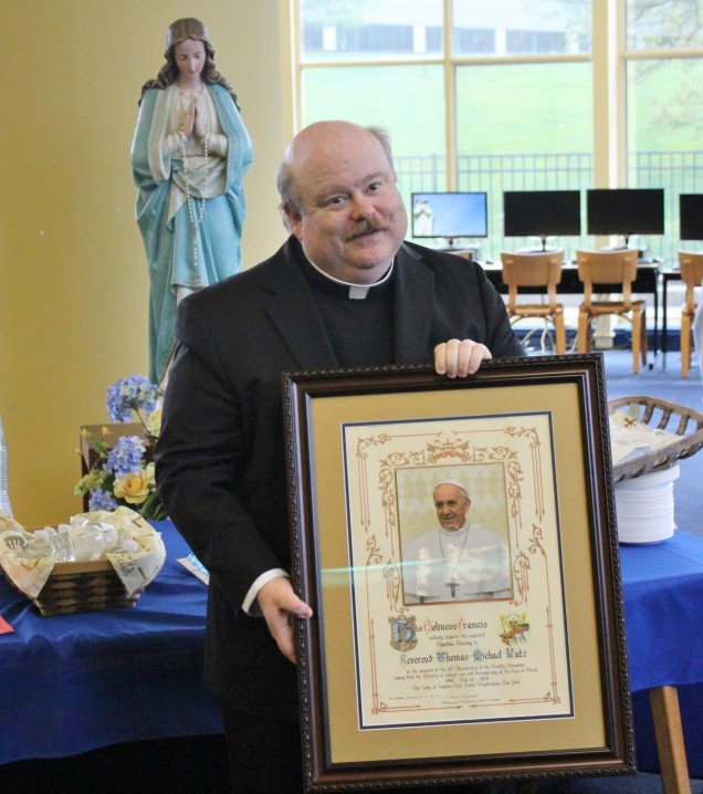 Father shares the papal blessing that he received as a gift from Mrs. Merryman on behalf of the s...