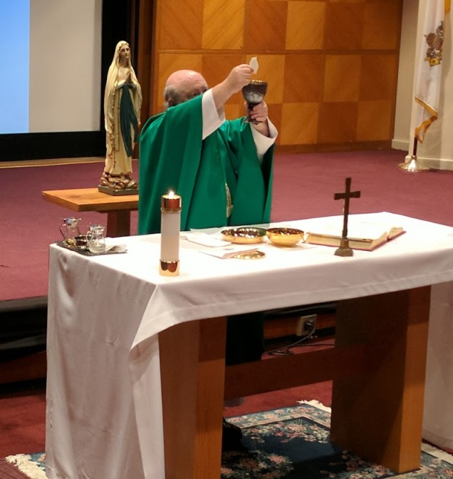 Father Lutz celebrates Mass for the administration, faculty and staff.