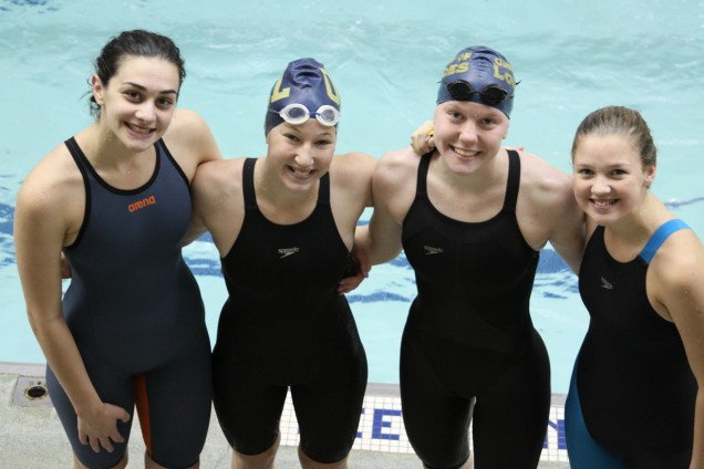 Eleanor Bolander, Valerie Bubel, Clare, Bosse and Genevieve Bernhardt pose after their record-set...