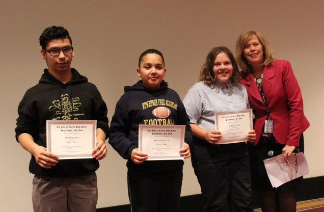 Awards in Visual Arts. From left to right: Third place Jumir Ramos from St. Mary Wappingers. Seco...
