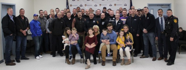 The Wiegard Family poses with the Town of Poughkeepsie Police Department after the check presenta...