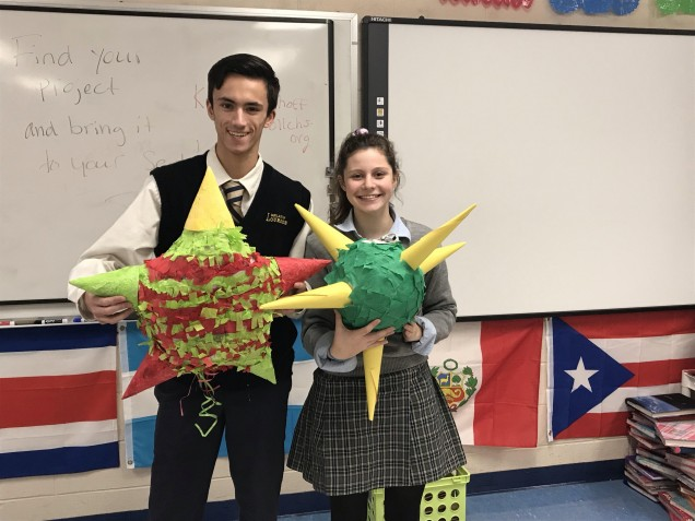 Chase Lois and Claire Bottjer pose with their piñatas.