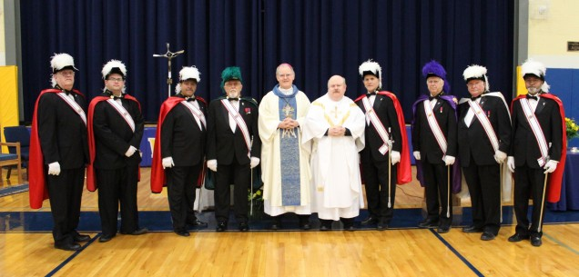 Bishop Byrne, Father Lutz and the 4th Degree Color Guard of the Knights of Columbus pose prior to...