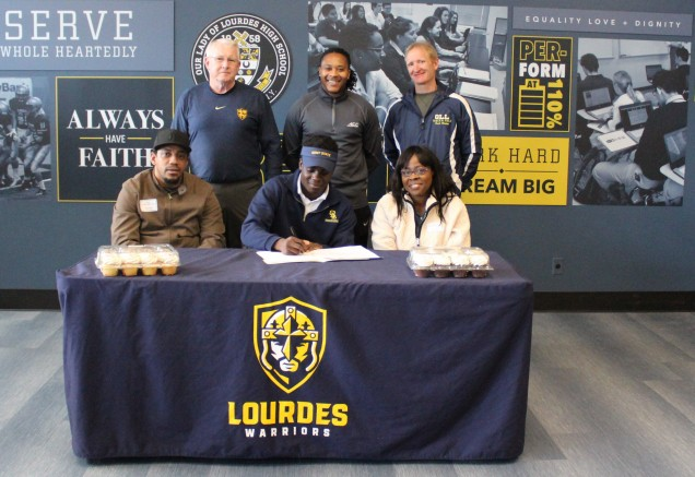 Jaheim signing with his mother, stepfather, Coach Walsh, our athletic trainer Miles Hansen, and  ...
