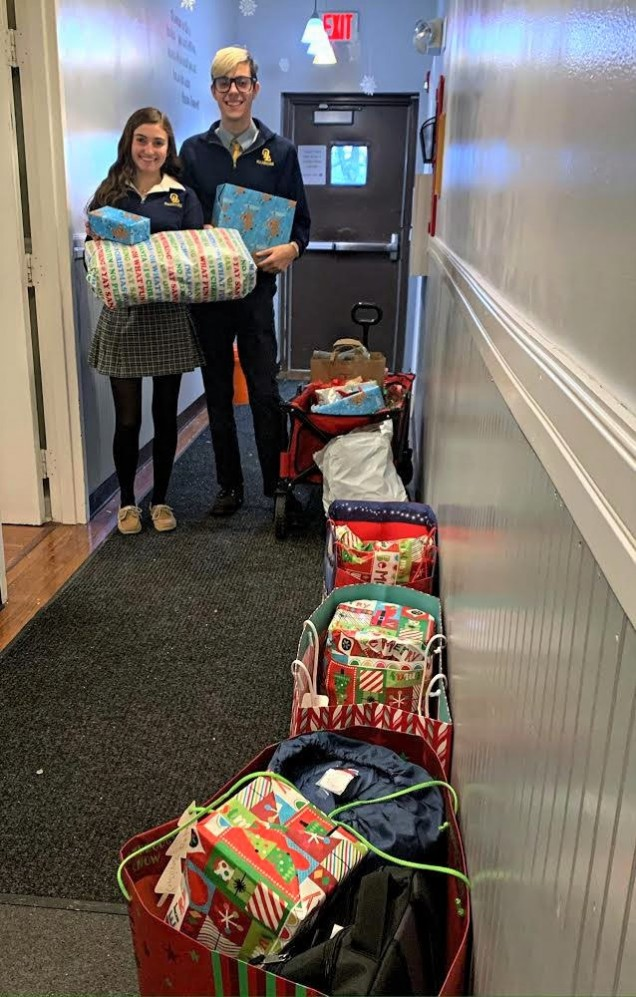 Bella Minuta and Carrick Sculley delivered donated items to the Grace Smith House for their Adopt...