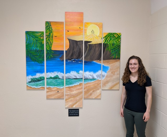 Stephanie Lehner poses in front of her mural.
