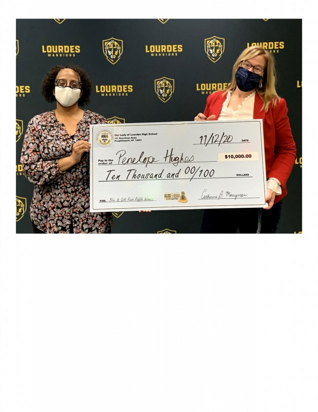 Penelope Hughes happily accepts the Grand Prize check for $10,000 from OLL Principal, Catherine M...